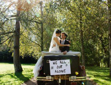 Bride and Groom on a wedding car
