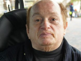 Photo of white, male wheelchair-user