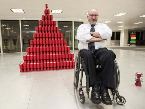 A recent recreation of 'Shaken Not Stirred' a sculpture made out of 1760 charity collection cans, in the shape of a pyramid
