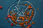 Star drawn in blue sand