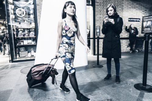 Woman with a suitcase walking through Kings X