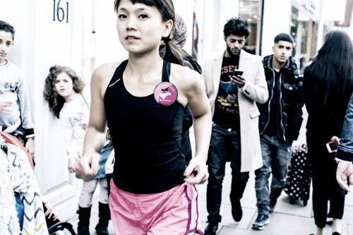 Woman running through a crowd