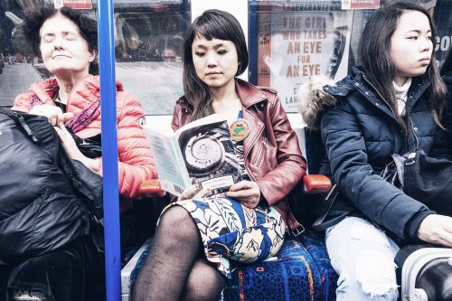 Woman reading on the tube