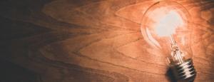 Light bulb on a wooden desk
