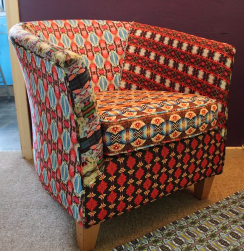 Chair upholstered with kaleidoscopic patterns