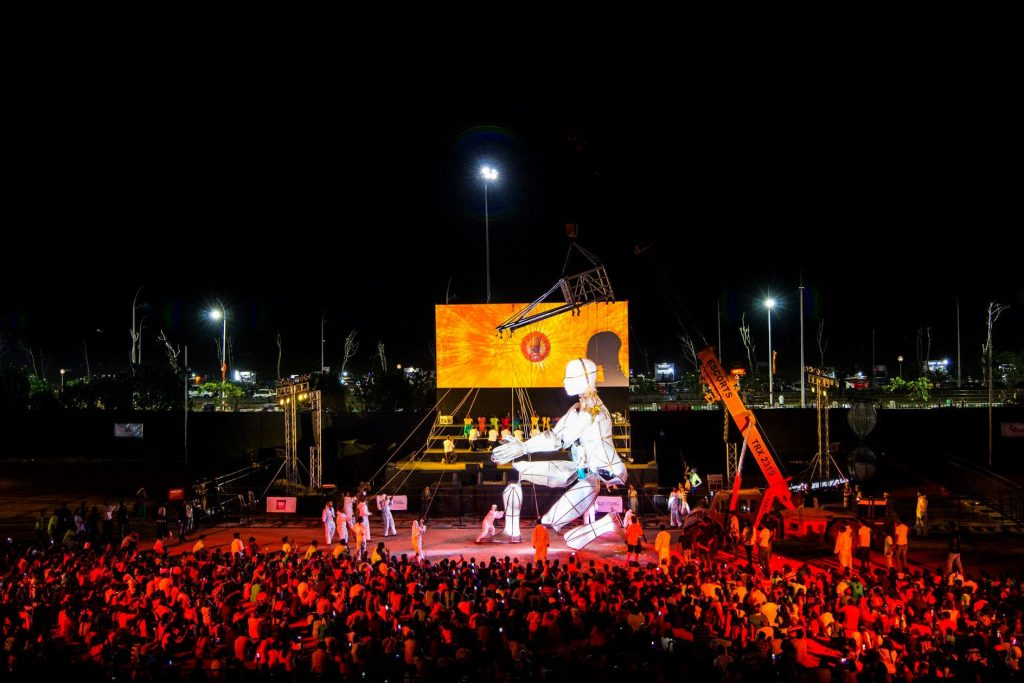 8-metre illuminated puppet in front of a large crowd