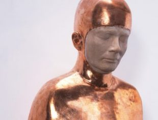Sculpture of man in copper full bodysuit, all is covered except for his face