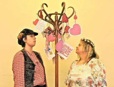 Rosalind and Celia find love poems on the trees.
