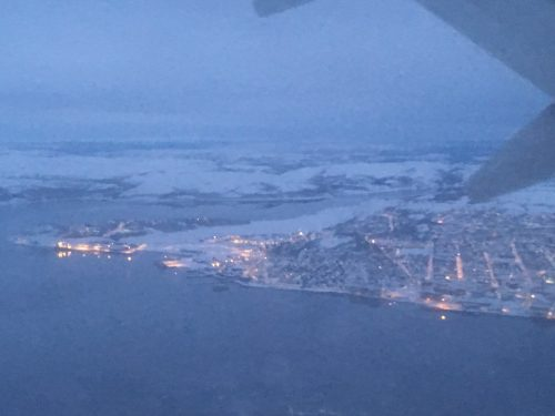 Photo taken outside a plane window coming into land at Kirkenes