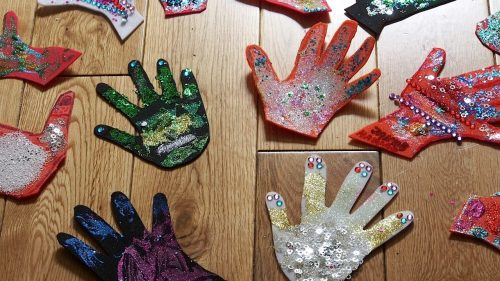 Colurful hands made of arts and crafts material