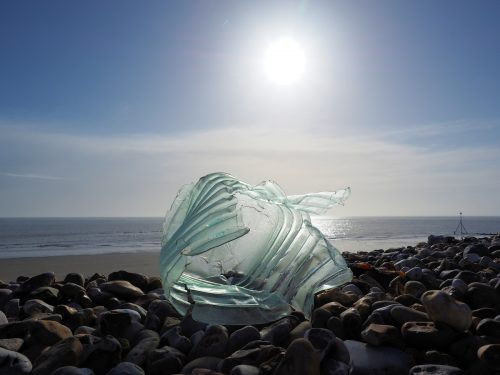 A dramatic photo of a piece of plastic rubbish on the seashore