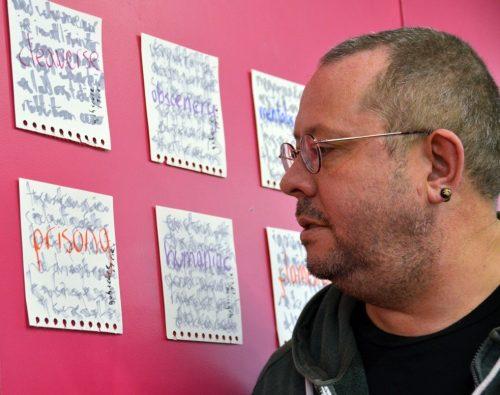 sean burn looking at a wall of artworks