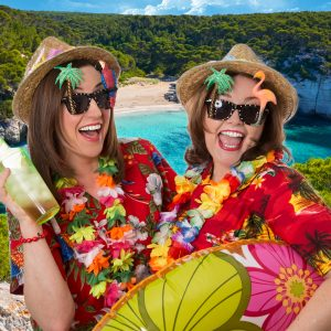 Two women in tropical holiday gear