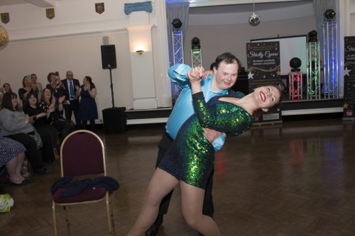 Jonathan dancing salsa with his professional partner