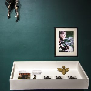 Photo of a white case with various objects from Adam Reynolds archive