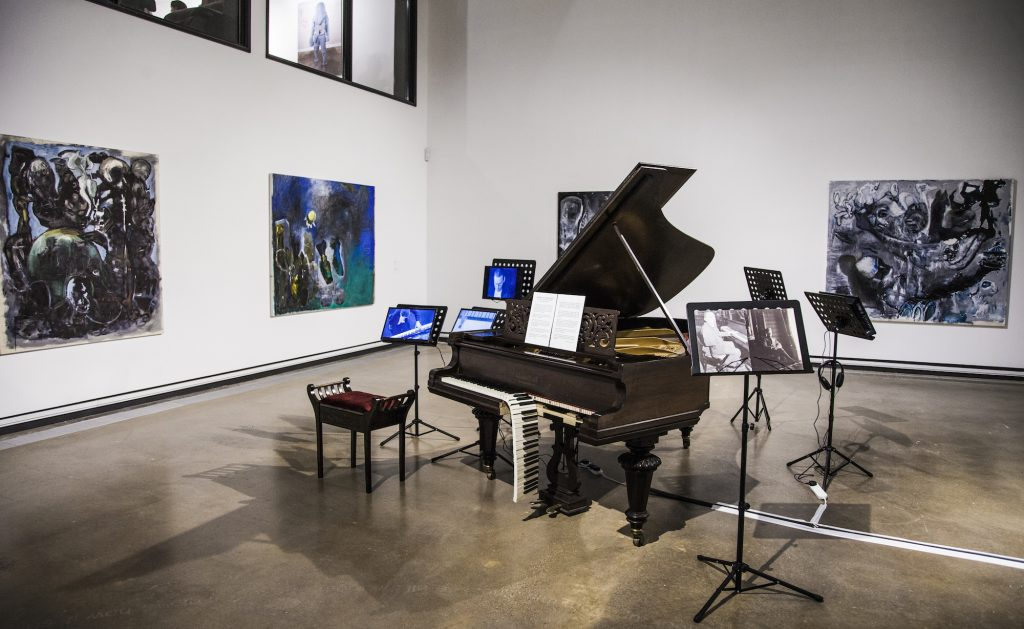 Photo of a grand piano with its keyboard half hanging down