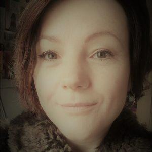 Headshot of Lisette Auton in soft sepia tones