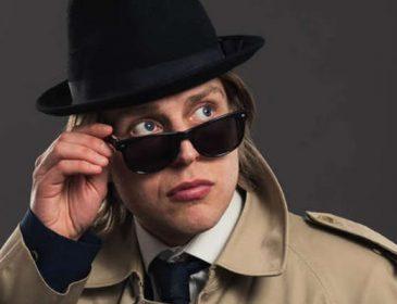 Tom Skelton in large overcoat
