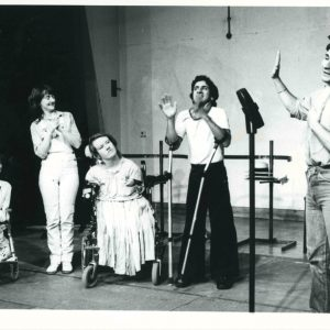 Black and white photo of 5 actors rehearsing a musical number
