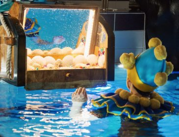 Performer in a pool for Splish Splash