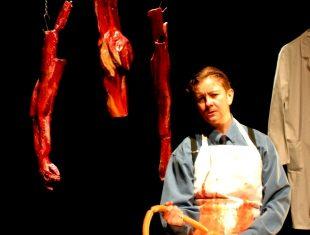 Julie McNamara handling meat