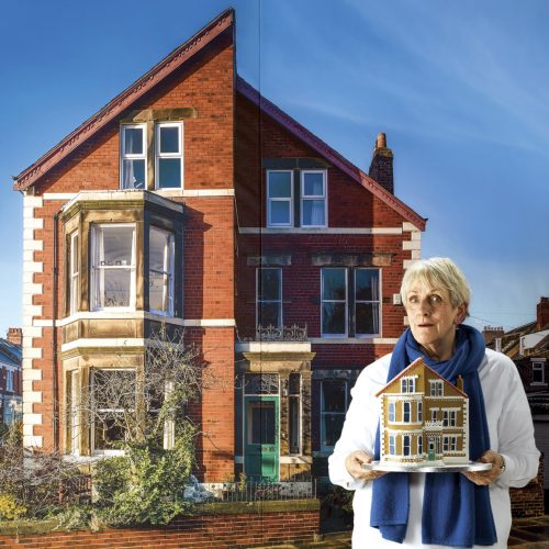 An edwardian house is pictured with teh artist Bobby Baker standing in front of it