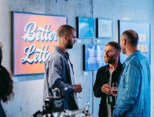3 men at an art preview