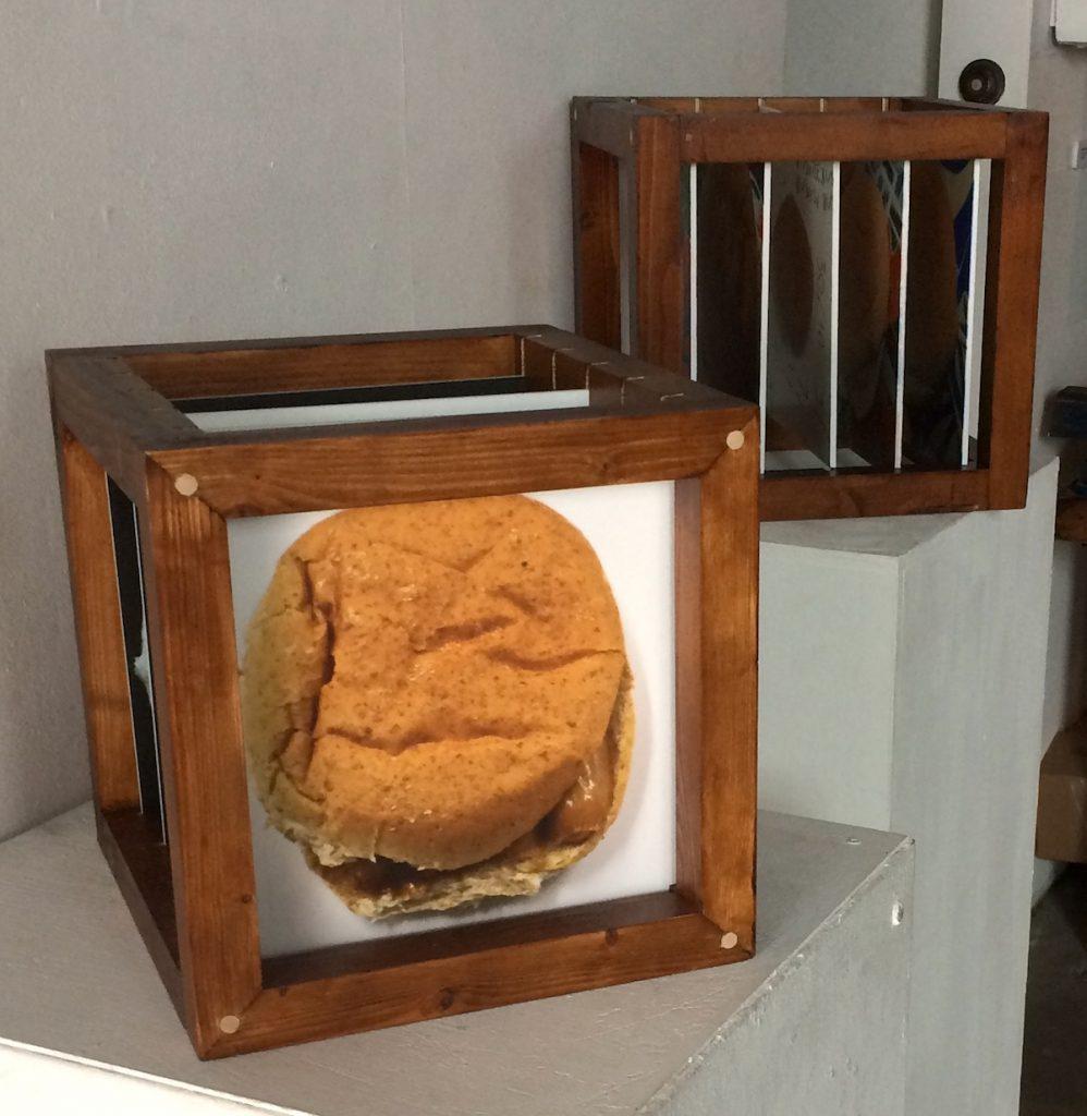 Image of a sculpture of a framed sausage bap