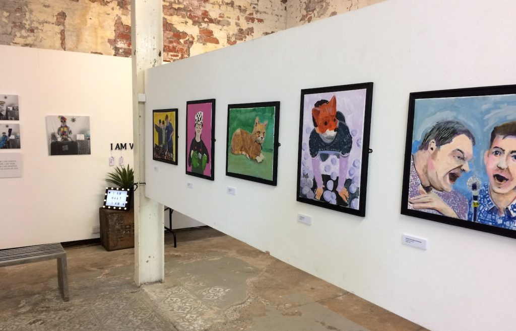 Photo of a display of gallery art