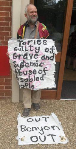 John Hoggett holding a banner