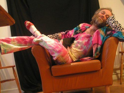 John Hoggett lying across an armchair
