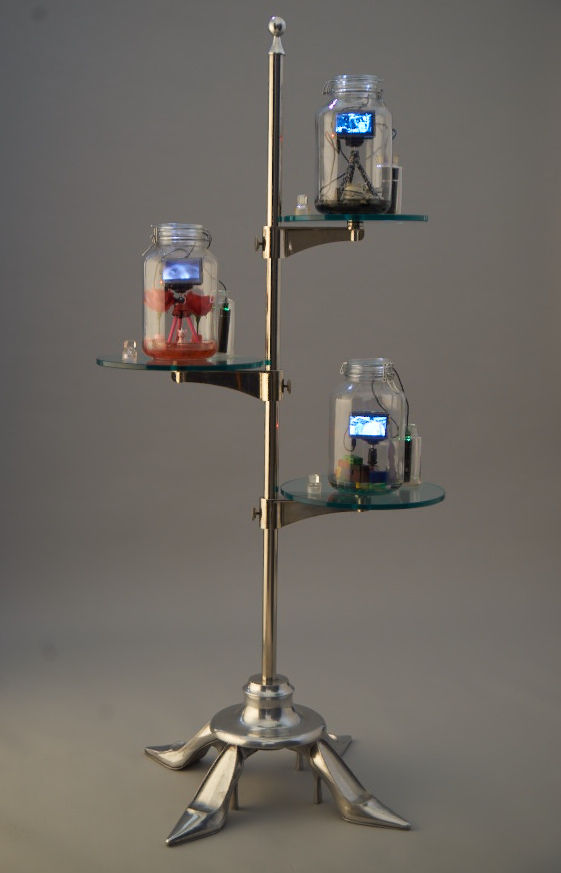 A series of glass jars perched tree-like on a vertical structure