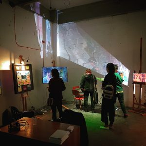 a group of people are pictured with an installation in a gallery space