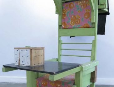 A large wooden green chair