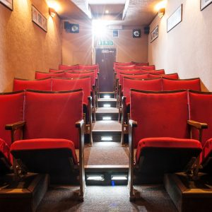 an auditorium of red chairs