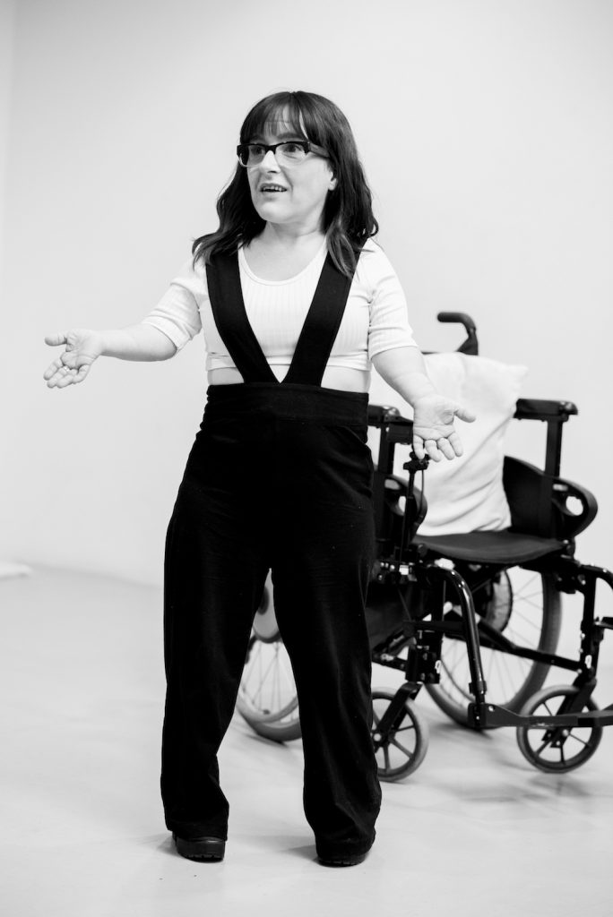 black and white photo of the actress Lisa Hammond standing