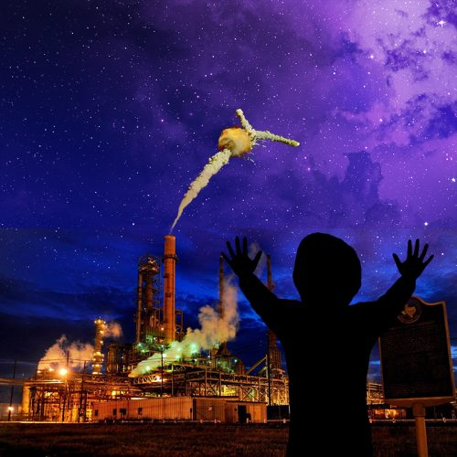 A silhouette with upraised hands strikes a pose against a purple sky over an industrial complex