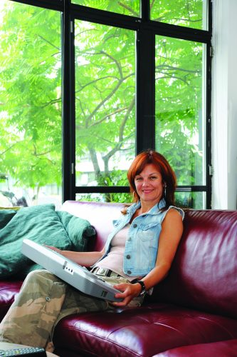 Liz Bentley sitting on a couch