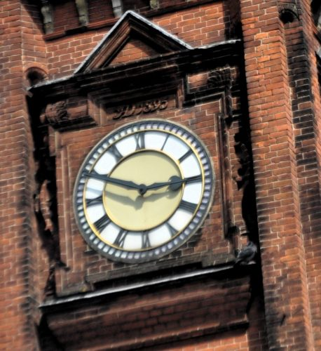 photo of a large brick clock tower