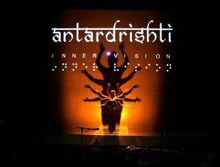 poster image of an indian classical dancer on stage under the title of the performance, Antardrishti - also written in braille