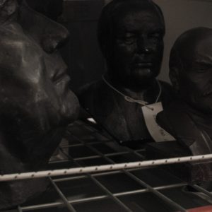 Film still showing busts