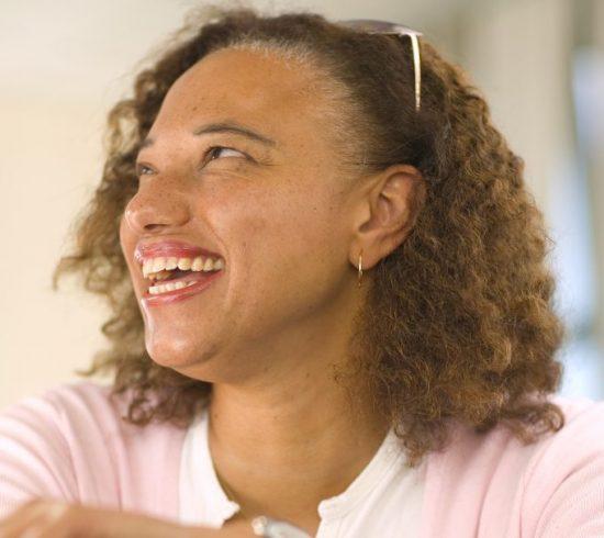 portrait of Maria Oshodi smiling at the camera