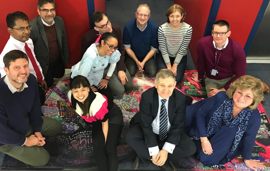 Group of people sitting on a carpet