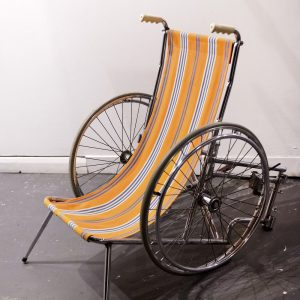 sculpture consisting of a deckchair with wheels