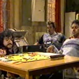 Still of a group of disabled actors sitting around a table