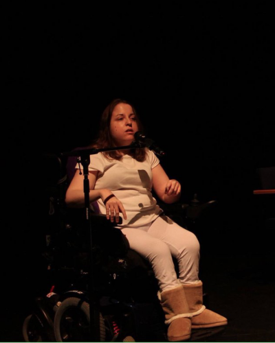 Kay performing her poetry live on stage
