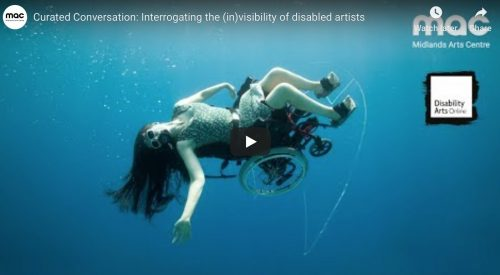 a woman in a wheelchair flies underwater in a wheelchair