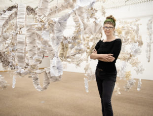Anna Berry standing in front of installation