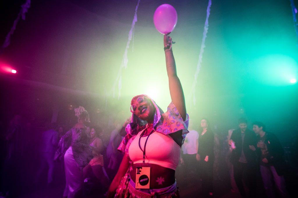 Person holding a ballon above their head