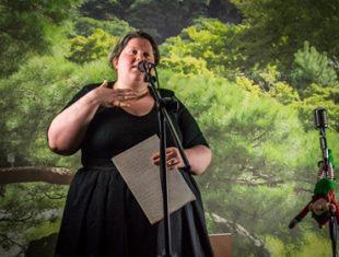 Woman behind microphone